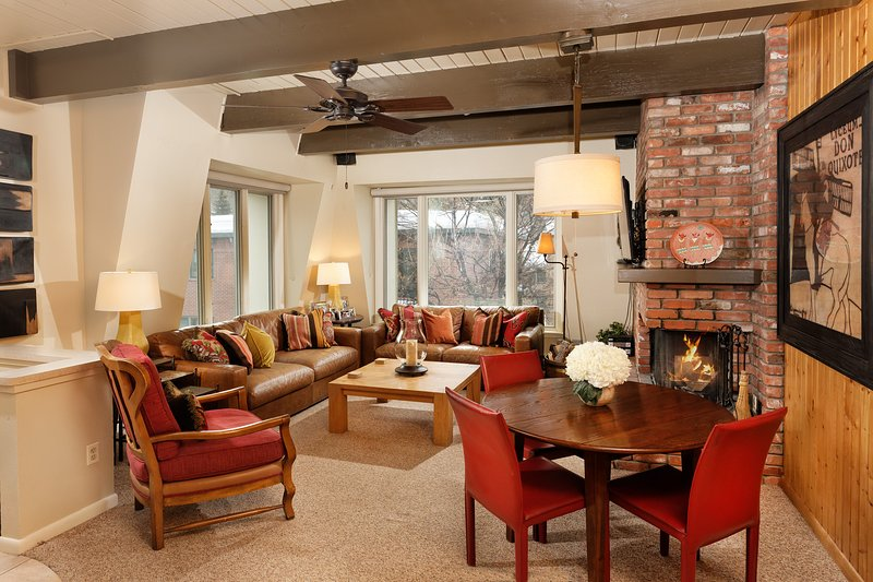 Cheerful living room with leather couches and a wood burning fireplace. - Location, Location, Location 150 Yds to Gondola - Aspen - rentals