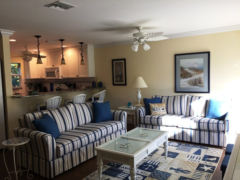 Sunlight coming into the living room from the front lanai - TOTAL REMODEL FINISHED 02/01/2017!!  CLOSE TO BEACH & BEST VALUE ON SANIBEL! - Sanibel Island - rentals