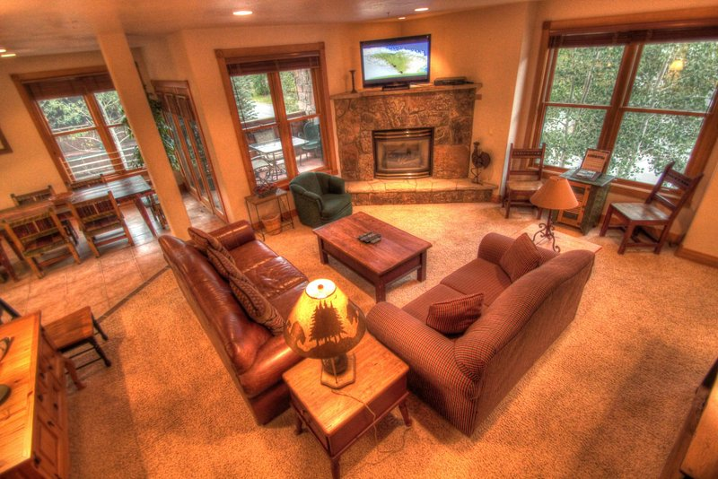 """SkyRun Property - """"River Run Mill Creek Combo"""" - Living Room - Both living rooms have a gas fireplace and a TV. - River Run Mill Creek Combo - Keystone - rentals"""