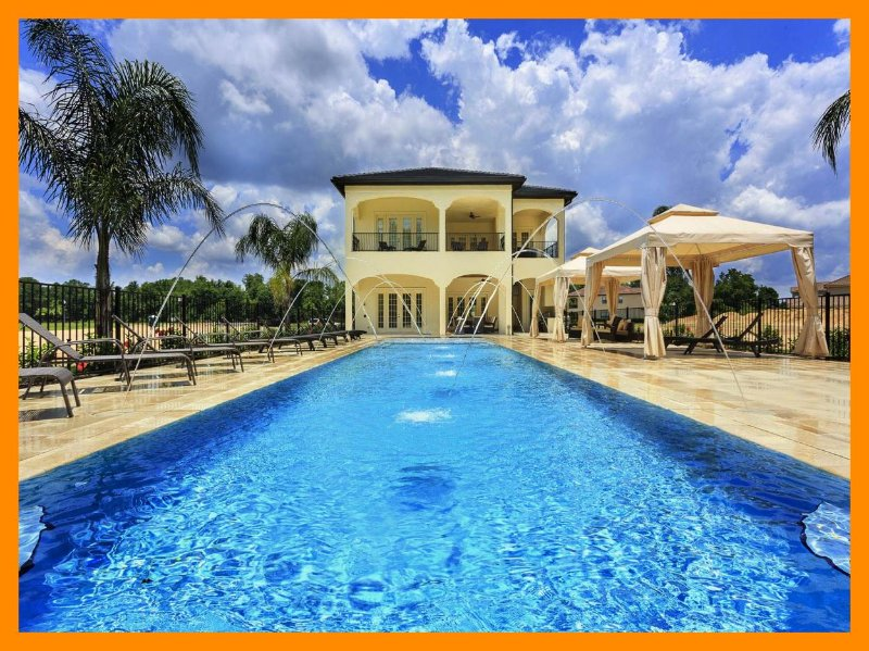 9 bed home, huge Miami style pool/spa with cabanas, cinema, gym, games, golf putting green - Image 1 - Reunion - rentals
