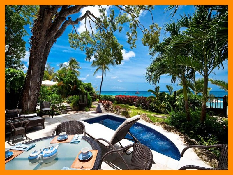 Charming 2 Bedroom Beachfront Apartment - Image 1 - Paynes Bay - rentals