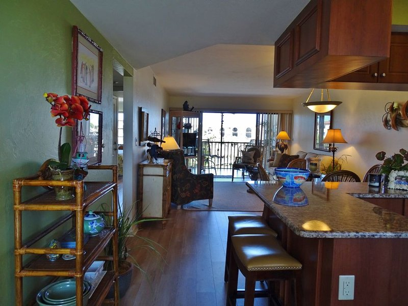 living area long view - TROPICAL decor awaits in this lovely condo located in Popular Resort - Marco Island - rentals