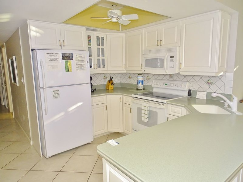 Kitchen - Glorious Balcony views of Shimmering Gulf of Mexico Beach Await You ! - Marco Island - rentals