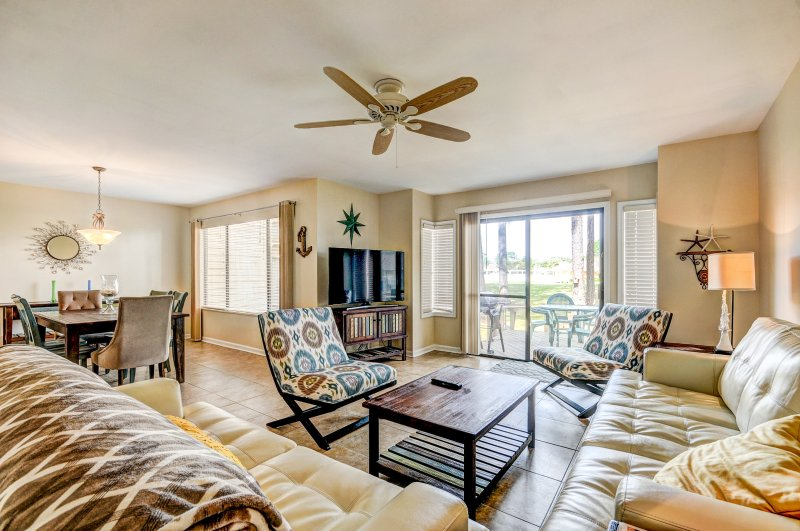 Open concept living and dining room overlooking an incredible view of the golf course and bay. - Fairways 261 Sandestin - Miramar Beach - rentals