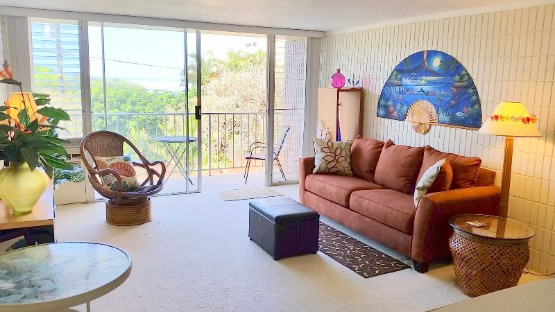 Living Room and Lanai (with table and chairs). Great for breakfast and sunsets!  Includes Sofabed, LCD TV, DVD, stereo, CD and wireless Internet. - Beautiful North Shore Oahu - 1Br/1Ba - Partial Ocean View - Waialua - rentals