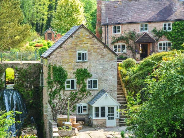 MILL COTTAGE, WiFi, former watermill, luxurious accommodation, wood-fired hot - Image 1 - Tenbury Wells - rentals