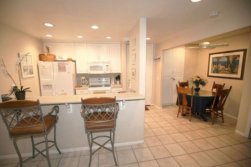 Kitchen has been remodeled with Corian counters and an open concept - A209 - Sandy Paradise - Oceanside - rentals