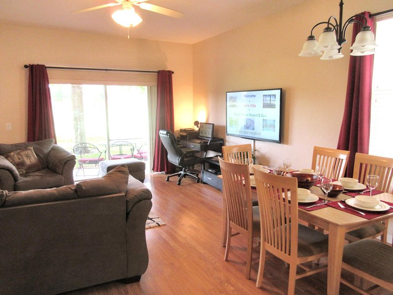 New easy-to-maintain laminate wood floor and, sofa, loveseat, chair and rugs - Ian's Villa at Regal Palms - Premium Upgraded 4BR Lakeside near Disney - Davenport - rentals