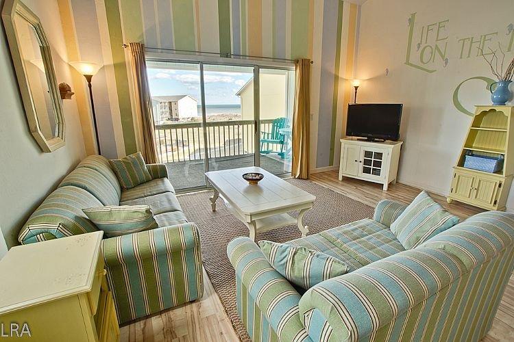 Living Room - Surf Condo 332 - Magnificent Ocean View, Coastal Decor, Pool, Beach Access - Surf City - rentals