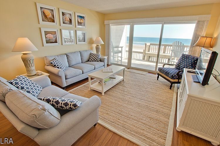 Living Room - Queen's Grant E-116 - Dynamic Oceanfront View, Pool, Hot Tub, Boat Ramp & Dock - Topsail Beach - rentals
