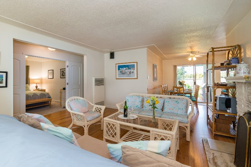 Living room, dining room with hardwoods, gas fireplace, access to patio in back, deck in front. - Kate's Cottage by the Sea: A Family Retreat in Santa Cruz, CA.  Walk to Beach! - Santa Cruz - rentals