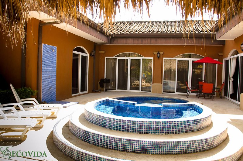 Private courtyard with pool, lounge chairs, BBQ, Patio table and hammock - EcoVida Casa de los Sueños with Private Pool! Walk to the Beach! - Playa Bejuco - rentals