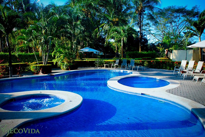 Casa Sol is in a beautiful gated community with two huge community pools - EcoVida Casa Sol - Solar Powered and Walk to the Beach! - Playa Bejuco - rentals