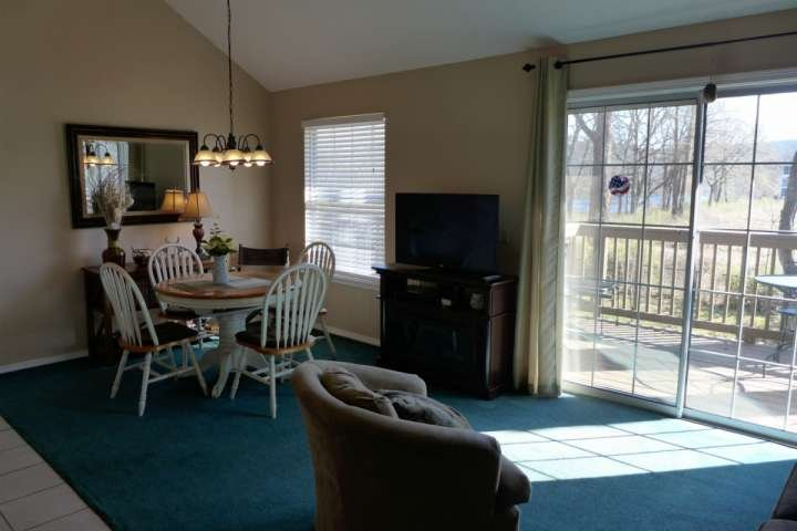 Living/Dining Room Area with Private Entrance to Your Private Deck. - Lake Taneycomo 2BDR Condo in Fall Creek Resort (42-9) - Branson - rentals