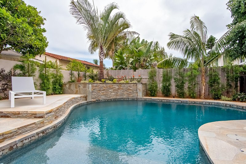The private pool is kept heated to a comfortable 80 degrees. - Family Friendly Home With Pool, Fire Pit, Hot Tub, Pool Table & More. 5 Minutes to LEGOLand! - Carlsbad - rentals