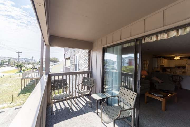 Enjoy morning coffee or evening beverages on this balcony. - Pelican Pass pleasure - Surfside Beach - rentals
