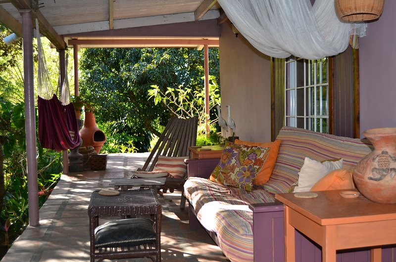 Covered Terrace overlooking small jungle park. Great spot for morning coffee. - BEST Rental In Town! Pine Cottage -Artsy, Comfy, Spacious. Spectacular Grounds. - Rio Hato - rentals