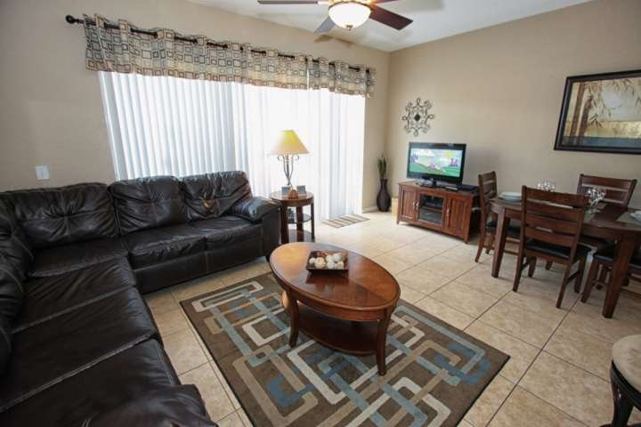 Living Area w/Flat Screen TV and Patio Access - 7669 Windsor Hills - Kissimmee - rentals
