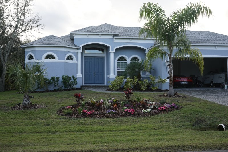 Updated front garden view - Luxury Home, w/ Pool, Lanai, Premium Appointments - Punta Gorda - rentals