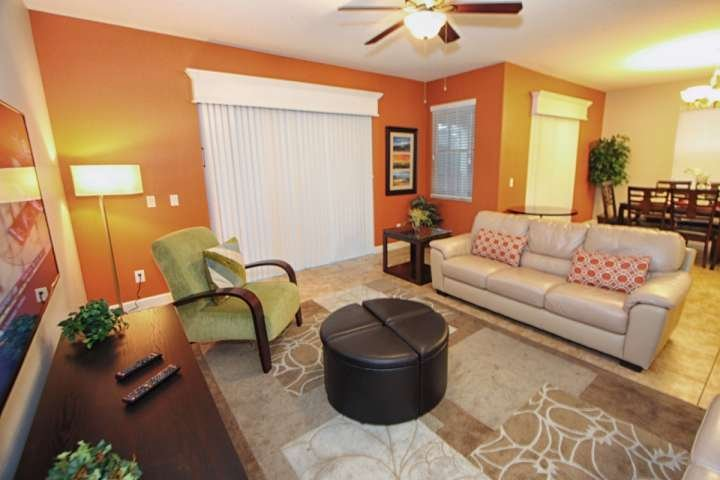 Comfortable & Modern Living Area with Wall Mounted Flat Screen TV & Pool Access - Paradise Villa, near Disney, with Sauna and Hot Tub - Kissimmee - rentals