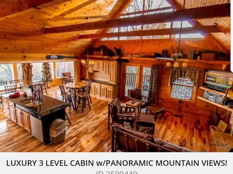 Inside view of family room - LUXURIOUS CABIN WITH GLASS PORCH AND PANORAMIC MAJESTIC MOUNTAIN VIEWS! - Sevierville - rentals
