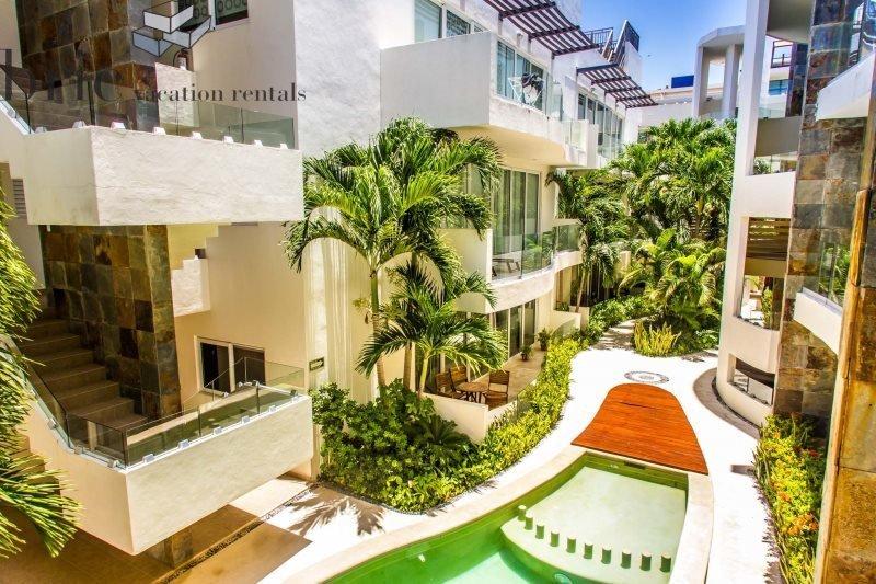 Beautiful 2 Bedroom, Ground Floor, Corner unit just steps from the beach - Image 1 - Riviera Maya - rentals