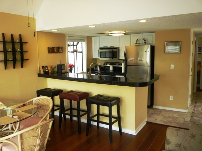 Beautiful Vacation Condo- Wood Floors, Paddle Fans, High End Appliances..10340 - Image 1 - Arcadian Shores - rentals