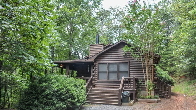 WOODSONG FORMERLY BLUEBERRY HILL- 3BR/2.5BA- WOODED CABIN SLEEPS 7, HOT TUB - Image 1 - Blue Ridge - rentals