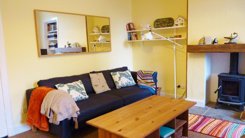 """sunny yellow living room with a big comfy couch. - """" Cosy Corner apartment """" 7 Crawford Street, Millport, Isle of Cumbrae - Millport - rentals"""