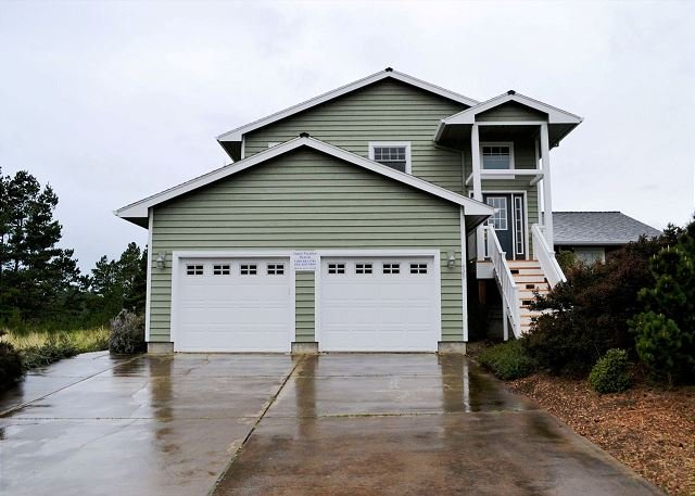 Front view of Sea Escape from the road. - SEA ESCAPE~ MCA# 898 ~Spacious home with golf course view and hot tub! - Manzanita - rentals