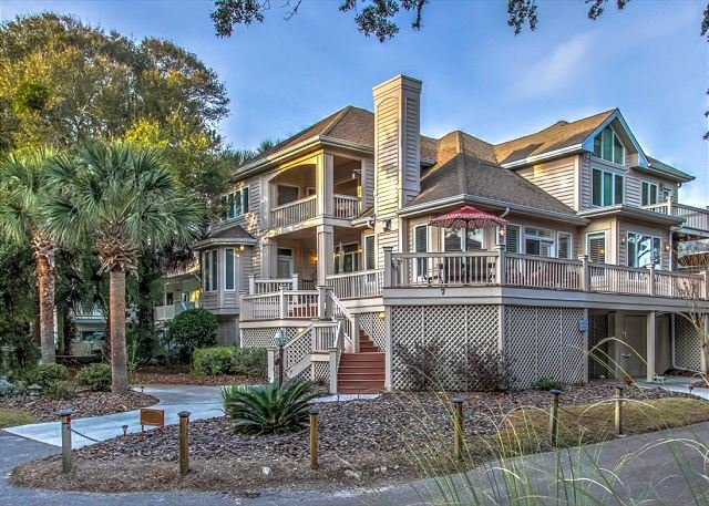 Exterior - 7 Quail-2nd Row Ocean, with a glimpse of the ocean from the porch. Sleeps 12 - Hilton Head - rentals