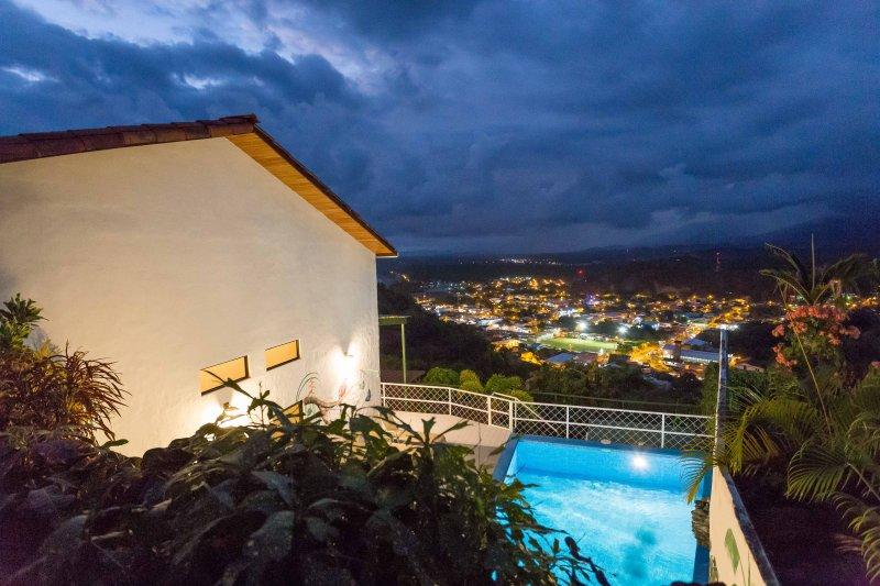 Casa Moreno in the evening with the lights of Quepos below. - Casa Moreno, Manuel Antonio, Costa Rica. - Manuel Antonio National Park - rentals