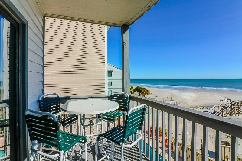Oceanfront family friendly condo, walk to pier + restaurants, amazing view! - Image 1 - Surfside Beach - rentals