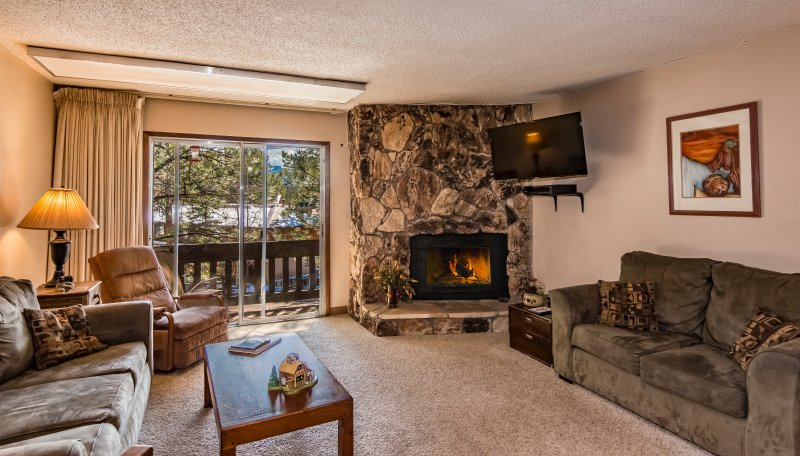 """Spacious living area with new 43"""" Sharp 4K Smart TV, Dish Network, and DVD/VCR.  COMFY! - Spacious!  2 Bed 2 Bath Ski & Bike Condo in Angel - Angel Fire - rentals"""