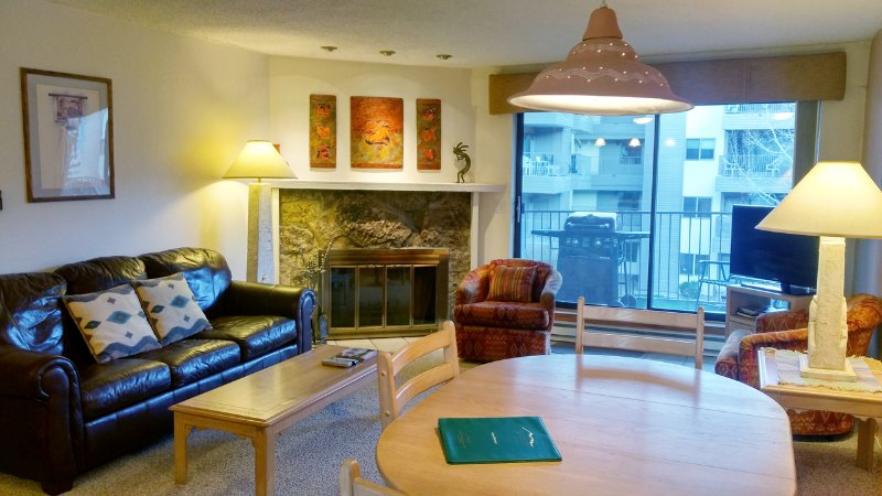 BC West Condo L-3 Living room with sofa bed, wood fireplace, dining table, and balcony with gas BBQ - BC West L-3 w/ FREE Skier Shuttle - Avon - rentals