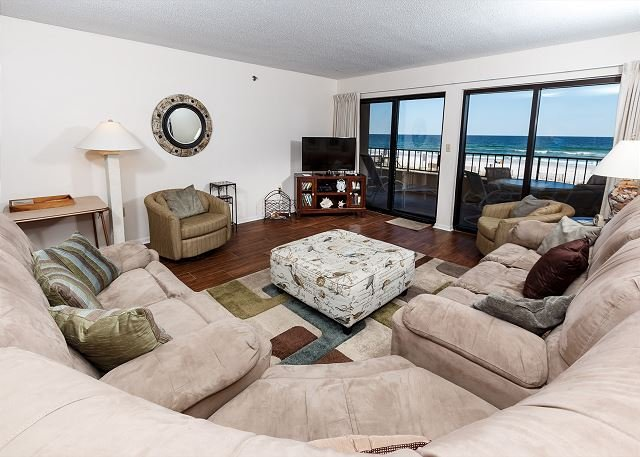 The living area is large and inviting. Light brown sectional sof - SD 208:Large beachfront unit- WiFi, balcony, pool, tennis,Free Beach Chairs - Fort Walton Beach - rentals