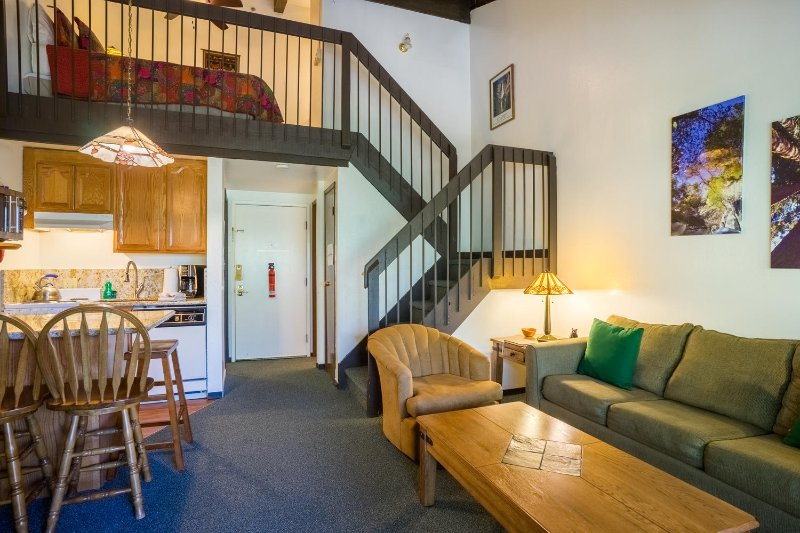 """View of both levels of the condo.  Living area, kitchen and loft. - """"Woodland Treasures""""   Yosemite West Loft Condo - Yosemite National Park - rentals"""