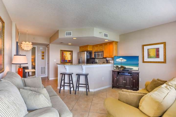 Living room with flat screen TV and convertible sofa. - 406 Dockside - Clearwater Beach - rentals