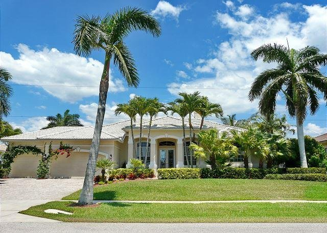 Modern waterfront house with heated pool and view of converging waterways - Image 1 - Marco Island - rentals