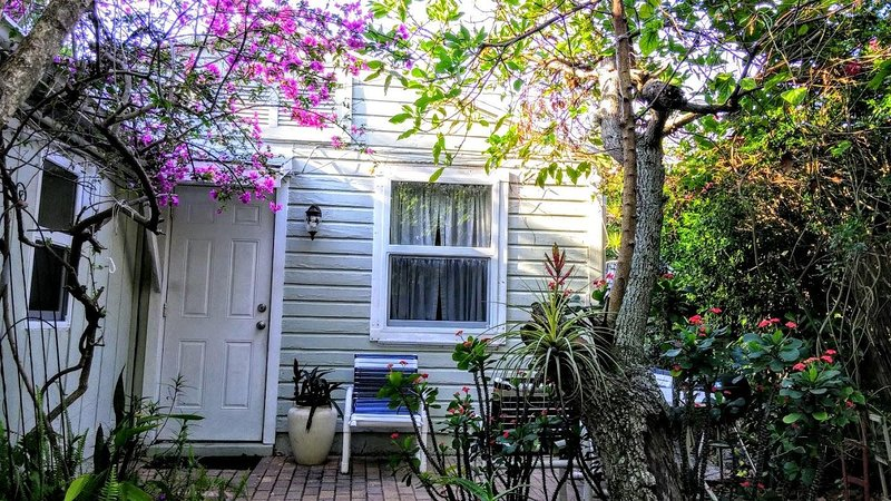 "Your front door opens from a private patio on the garden - ""Old Florida"" Garden Cottage With Shared Pool - West Palm Beach - rentals"