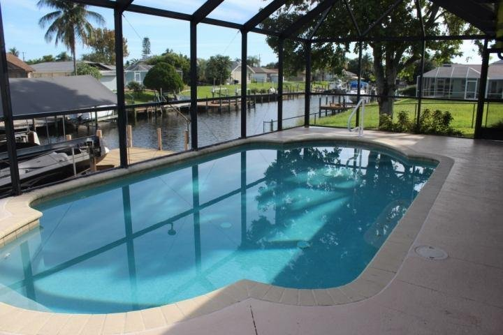 Sparkling heated pool and gulf access pool await you on vacation. - Gulf Access South East Canal Home - Cape Coral - rentals