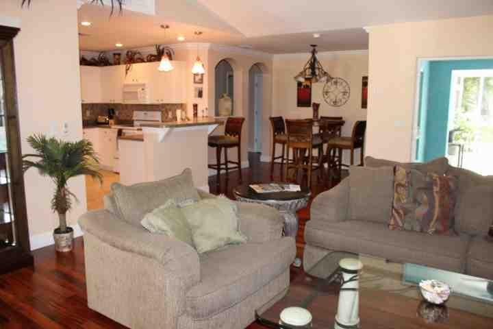 Kitchen, Dining and Living areas - Refresh From The Heat in This Awesome Pool Home - Cape Coral - rentals