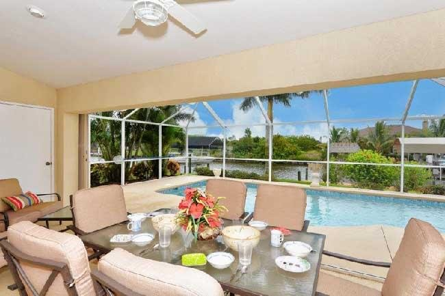 Lanai with outside dining and seating - South Gulf Cove 9454 - Port Charlotte - rentals