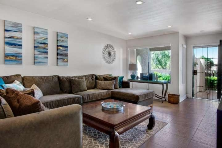 Bright and airy living space opens up to the patio to enjoy the desert breeze! - Breezy Condo! Best Location! Pool, Mountain Views & Tennis. Steps from El Paseo! - Palm Desert - rentals