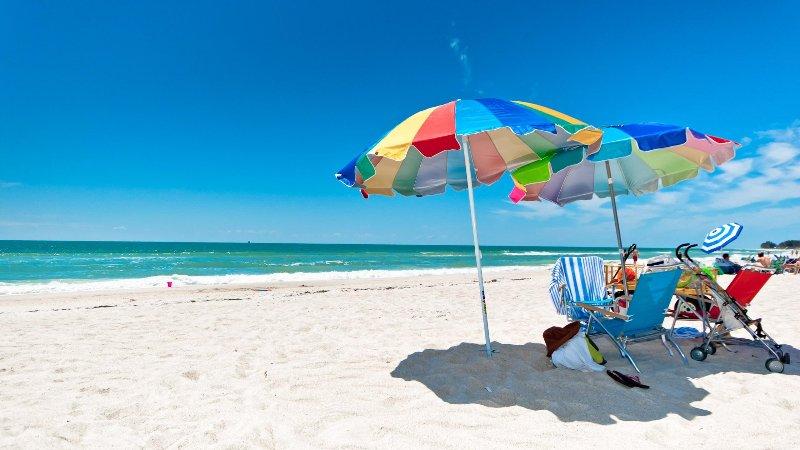 Umbrellas on our Gulf of Mexico beach - 5-Star Beachfront Condo on Anna Maria Island - Excellence Award - Holmes Beach - rentals