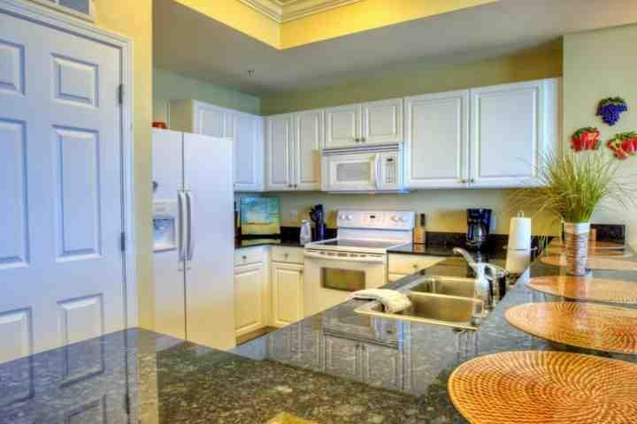 Granite counter tops frame this gorgeous kitchen.  Everything you need in this beautiful property! - 1706 Tidewater Beach Resort - Panama City Beach - rentals
