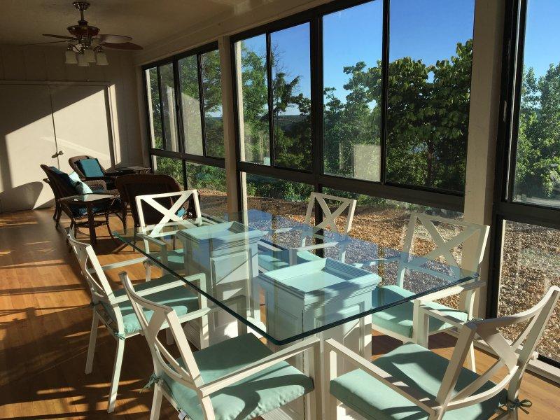 Dining table in 3 seasons room - Luxury Condo Large & Clean Osage Vistas fka 4 Seasons Country Club - Lake Ozark - rentals