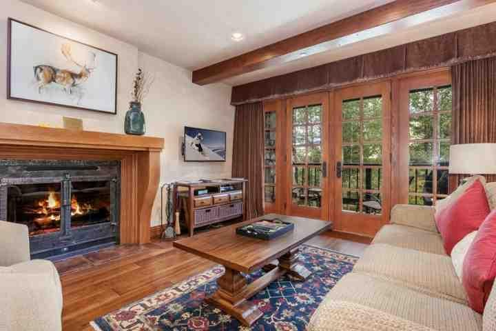 """Sunken living room with wood burning fireplace, 46"""" flat screen TV & DVD plus access to the deck with creek views. - Creekside Condo, Seasonal Pool & Year Round Hot Tub, Walk to Village, Great for - Avon - rentals"""