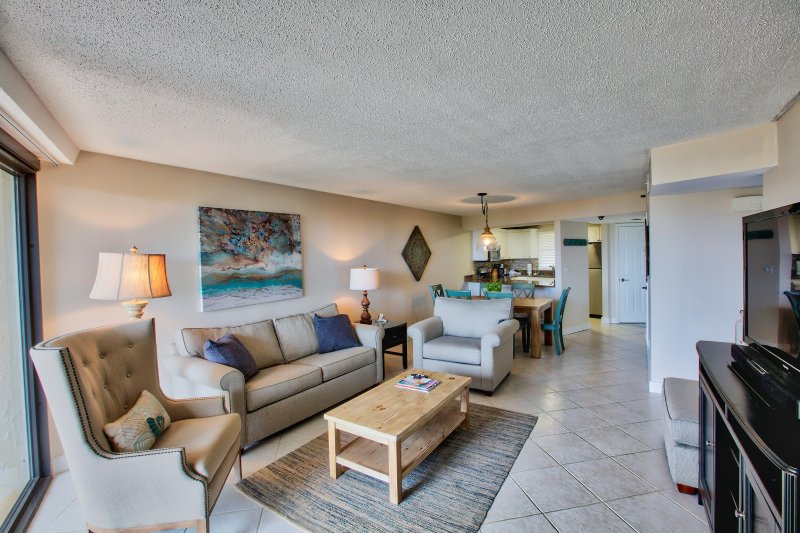Living room with dining room and kitchen in background - Beautiful Gulf Front - Upscale - Great Location - Sandestin - rentals