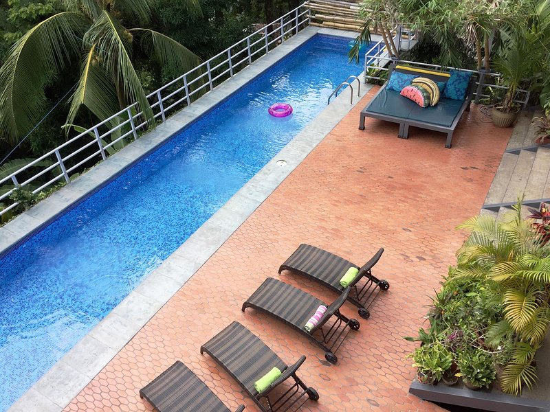 Newly-tiled pool deck and the salt-water lap pool - Casa Carpe Diem - Ultra Modern Villa - Manuel Antonio National Park - rentals